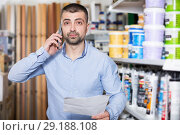Купить «male with shop list is calling wife for ask about modern color», фото № 29188108, снято 16 февраля 2018 г. (c) Яков Филимонов / Фотобанк Лори