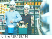 Купить «Adult woman with man in helmet with instruments», фото № 29188116, снято 16 февраля 2018 г. (c) Яков Филимонов / Фотобанк Лори