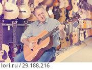 Купить «male is playing on acoustic guitar», фото № 29188216, снято 18 сентября 2017 г. (c) Яков Филимонов / Фотобанк Лори