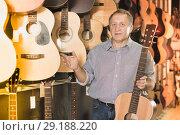Купить «male is standing with modern guitar», фото № 29188220, снято 18 сентября 2017 г. (c) Яков Филимонов / Фотобанк Лори