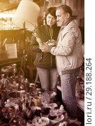 Купить «Senior man and female at traditional flea market», фото № 29188264, снято 23 октября 2017 г. (c) Яков Филимонов / Фотобанк Лори