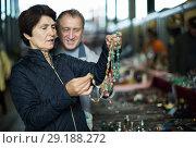 Купить «Happy man and woman at traditional flea market», фото № 29188272, снято 23 октября 2017 г. (c) Яков Филимонов / Фотобанк Лори
