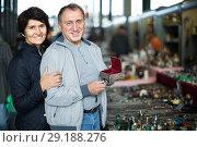 Купить «satisfied mature spouses buying retro handicrafts on flea market», фото № 29188276, снято 23 октября 2017 г. (c) Яков Филимонов / Фотобанк Лори