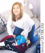 Купить «Girl starting packing luggage for journey at home», фото № 29188332, снято 22 марта 2017 г. (c) Яков Филимонов / Фотобанк Лори