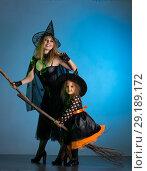 Купить «Mom and daughter holiday of halloween», фото № 29189172, снято 30 сентября 2018 г. (c) Типляшина Евгения / Фотобанк Лори
