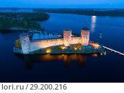 Купить «Вид на старинную крепость Олавинлинна июльской ночью (аэросъемка). Савонлинна, Финляндия», фото № 29200216, снято 24 июля 2018 г. (c) Виктор Карасев / Фотобанк Лори