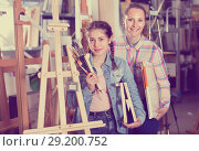 Купить «Mother and teen girl holding supplies for painting in hands», фото № 29200752, снято 12 апреля 2017 г. (c) Яков Филимонов / Фотобанк Лори