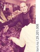 Купить «Friendly worker selling vegetables to female customer», фото № 29201008, снято 27 января 2020 г. (c) Яков Филимонов / Фотобанк Лори