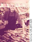 Купить «Seller with cassava roots at market», фото № 29201020, снято 18 октября 2019 г. (c) Яков Филимонов / Фотобанк Лори