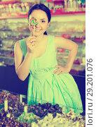 Portrait of young woman buying lollipop. Стоковое фото, фотограф Яков Филимонов / Фотобанк Лори