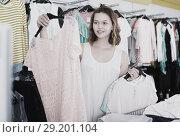 Купить «Woman shopping at the apparel store», фото № 29201104, снято 19 июня 2017 г. (c) Яков Филимонов / Фотобанк Лори