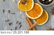 Купить «dried orange slices, anise, cinnamon and spices», видеоролик № 29201188, снято 7 октября 2018 г. (c) Syda Productions / Фотобанк Лори