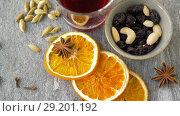 Купить «hot mulled wine, orange slices, raisins and spices», видеоролик № 29201192, снято 7 октября 2018 г. (c) Syda Productions / Фотобанк Лори