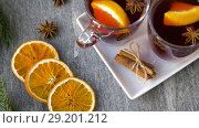 Купить «glasses of hot mulled wine with orange and spices», видеоролик № 29201212, снято 7 октября 2018 г. (c) Syda Productions / Фотобанк Лори