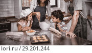 Купить «Happy family cooking biscuits together», фото № 29201244, снято 25 мая 2020 г. (c) Wavebreak Media / Фотобанк Лори