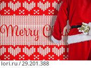 Купить «Composite image of santa clause holding a gift box behind his back», фото № 29201388, снято 21 октября 2018 г. (c) Wavebreak Media / Фотобанк Лори