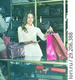 Купить «Portrait of woman selling wallets and purses», фото № 29206388, снято 21 октября 2018 г. (c) Яков Филимонов / Фотобанк Лори