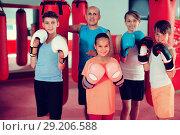 Купить «Group of young smiling boxer with coach standing», фото № 29206588, снято 12 апреля 2017 г. (c) Яков Филимонов / Фотобанк Лори