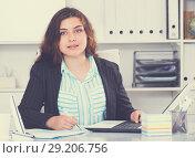 Купить «Young businesswoman is having productive day at work», фото № 29206756, снято 21 мая 2017 г. (c) Яков Филимонов / Фотобанк Лори