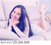 Купить «female resting and dreaming on sofa», фото № 29206808, снято 30 мая 2017 г. (c) Яков Филимонов / Фотобанк Лори