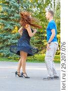 Купить «Russia, Samara, August 2017: Beautiful young couple dancing in Gagarin's Park on a summer day.», фото № 29207076, снято 17 сентября 2017 г. (c) Акиньшин Владимир / Фотобанк Лори