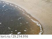 Купить «Sea wave on the sand», фото № 29214916, снято 24 сентября 2015 г. (c) Евгений Ткачёв / Фотобанк Лори
