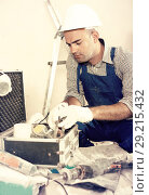 Купить «Worker builder searching tools for repair», фото № 29215432, снято 18 мая 2017 г. (c) Яков Филимонов / Фотобанк Лори