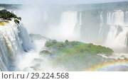 Купить «Cataratas del Iguazu Waterfall on Iguazu River in National Park, Parana, Brazil», видеоролик № 29224568, снято 22 марта 2017 г. (c) Яков Филимонов / Фотобанк Лори