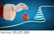 Купить «Santa holding Christmas bauble and Christmas tree», видеоролик № 29231280, снято 31 мая 2020 г. (c) Wavebreak Media / Фотобанк Лори