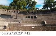 Купить «The ruins of old city debris of Turkish amphitheater. Archaeological Attraction. Ancient city Hierapolis near Marmaris in Turkey», видеоролик № 29231412, снято 20 октября 2018 г. (c) Сергей Тимофеев / Фотобанк Лори