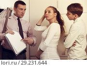 Купить «Mother and son struggling to pay bills», фото № 29231644, снято 28 марта 2017 г. (c) Яков Филимонов / Фотобанк Лори