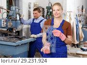 Купить «Female worker demonstrating drilled glass», фото № 29231924, снято 10 сентября 2018 г. (c) Яков Филимонов / Фотобанк Лори