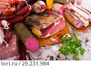Купить «Variety of meats on table», фото № 29231984, снято 18 октября 2018 г. (c) Яков Филимонов / Фотобанк Лори