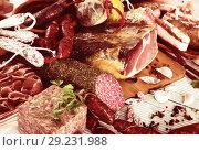 Купить «Variety of meats on table», фото № 29231988, снято 17 октября 2018 г. (c) Яков Филимонов / Фотобанк Лори