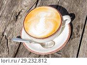 Good morning with aromatic coffee cappuccino in white cup with on table wooden in cafe. Стоковое фото, фотограф Алексей Ширманов / Фотобанк Лори
