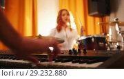 Купить «Repetition. Girl playing on drums and a guy on keyboards. Focus from hands to drums», видеоролик № 29232880, снято 8 июля 2020 г. (c) Константин Шишкин / Фотобанк Лори