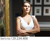 Купить «Woman visiting painting exhibition», фото № 29234408, снято 28 июля 2018 г. (c) Яков Филимонов / Фотобанк Лори