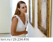 Купить «Woman visiting painting exhibition», фото № 29234416, снято 28 июля 2018 г. (c) Яков Филимонов / Фотобанк Лори