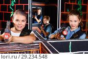 Купить «Modern young woman and teen girl with laser pistols playing laser tag in dark labyrinth», фото № 29234548, снято 3 сентября 2018 г. (c) Яков Филимонов / Фотобанк Лори