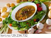 Купить «Tasty goulash from chicken hearts with lettuce at plate, fresh vegetables», фото № 29234732, снято 22 октября 2018 г. (c) Яков Филимонов / Фотобанк Лори