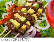 Купить «Tasty shish kebab from chicken hearts with avocado and lettuce at plate», фото № 29234780, снято 22 октября 2018 г. (c) Яков Филимонов / Фотобанк Лори