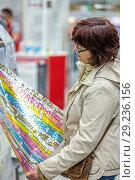 Купить «Beautiful mature woman chooses textile store.», фото № 29236156, снято 12 мая 2018 г. (c) Акиньшин Владимир / Фотобанк Лори