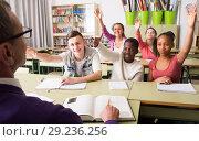 Купить «smiling students pull hands on lesson», фото № 29236256, снято 16 октября 2018 г. (c) Татьяна Яцевич / Фотобанк Лори