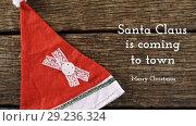 Купить «Santa Claus is coming to town and Christmas hat», видеоролик № 29236324, снято 2 октября 2018 г. (c) Wavebreak Media / Фотобанк Лори