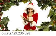 Купить «Santa woman opening gift with holly», видеоролик № 29236328, снято 2 октября 2018 г. (c) Wavebreak Media / Фотобанк Лори