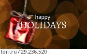 Купить «Happy holidays text and Christmas gift decoration», видеоролик № 29236520, снято 15 июля 2019 г. (c) Wavebreak Media / Фотобанк Лори