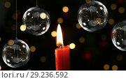 Купить «Christmas candle with decoration baubles and lights», видеоролик № 29236592, снято 17 февраля 2020 г. (c) Wavebreak Media / Фотобанк Лори