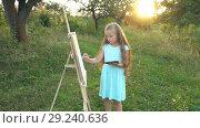Купить «Little girl draws on nature», видеоролик № 29240636, снято 31 августа 2018 г. (c) Kozub Vasyl / Фотобанк Лори
