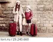 Купить «female with girl with baggage near wall», фото № 29240660, снято 19 ноября 2017 г. (c) Яков Филимонов / Фотобанк Лори