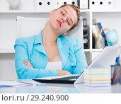 Купить «Female employee is sleeping after productive day at work», фото № 29240900, снято 9 июня 2017 г. (c) Яков Филимонов / Фотобанк Лори
